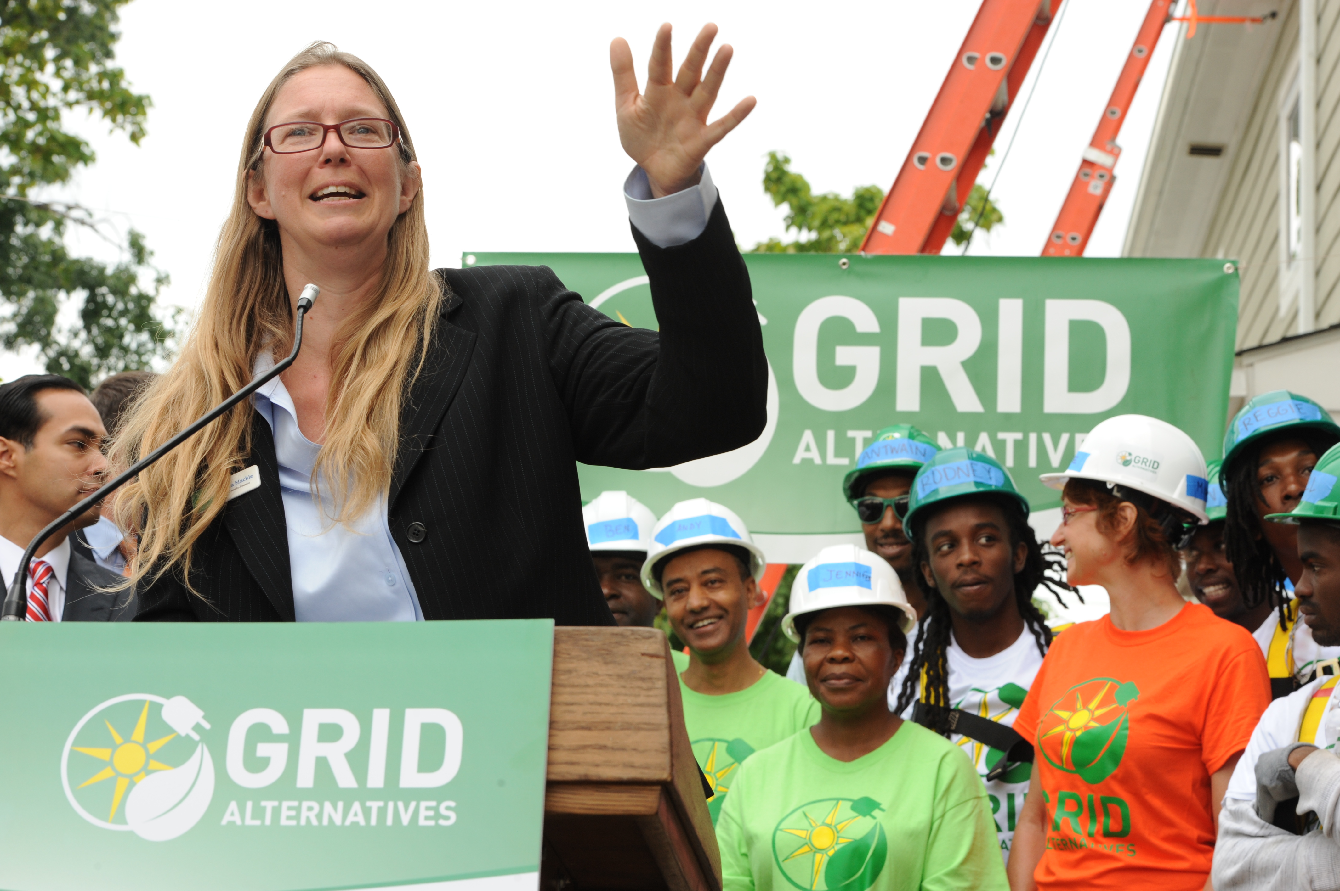 GRID Alternatives co-founder and CEO Erica Mackie speaks during GRID Mid-Atlantic's launch event in 2014.