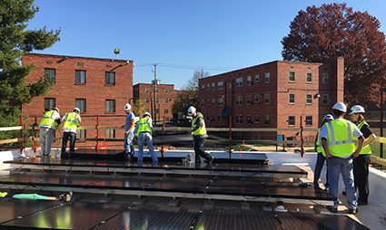Volunteers install solar on our first multifamily affordable housing project in Washington D.C.