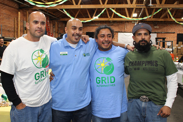 Jose Ramos poses in a photo with some of the GRID community members; Jose attributes his employment success in solar to GRID