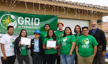 Picture of students receiving awards after solar installation training