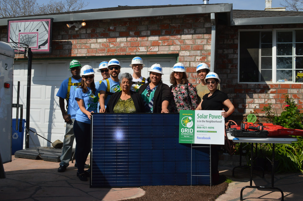 Homeowner Olivia Jaimez Parada with GRID volunteers and staff, as well as representatives from Facebook.