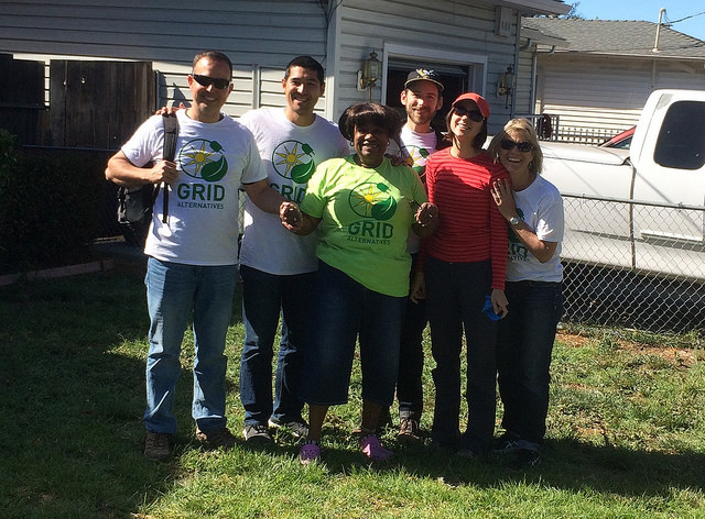 Dorothy, in green, is all smiles with the SunPower team that helped install her system at Solarthon
