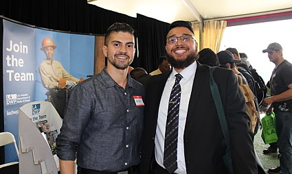 Nick and Adam smile at an event