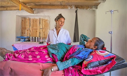 Sharada attends a patient at the Meteri Birthing Center