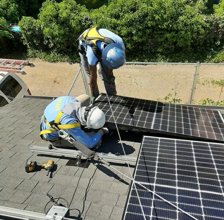 solar installers work on array