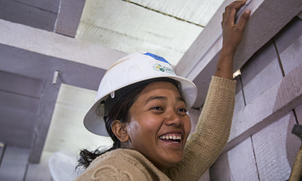 A Nepali woman works at the install