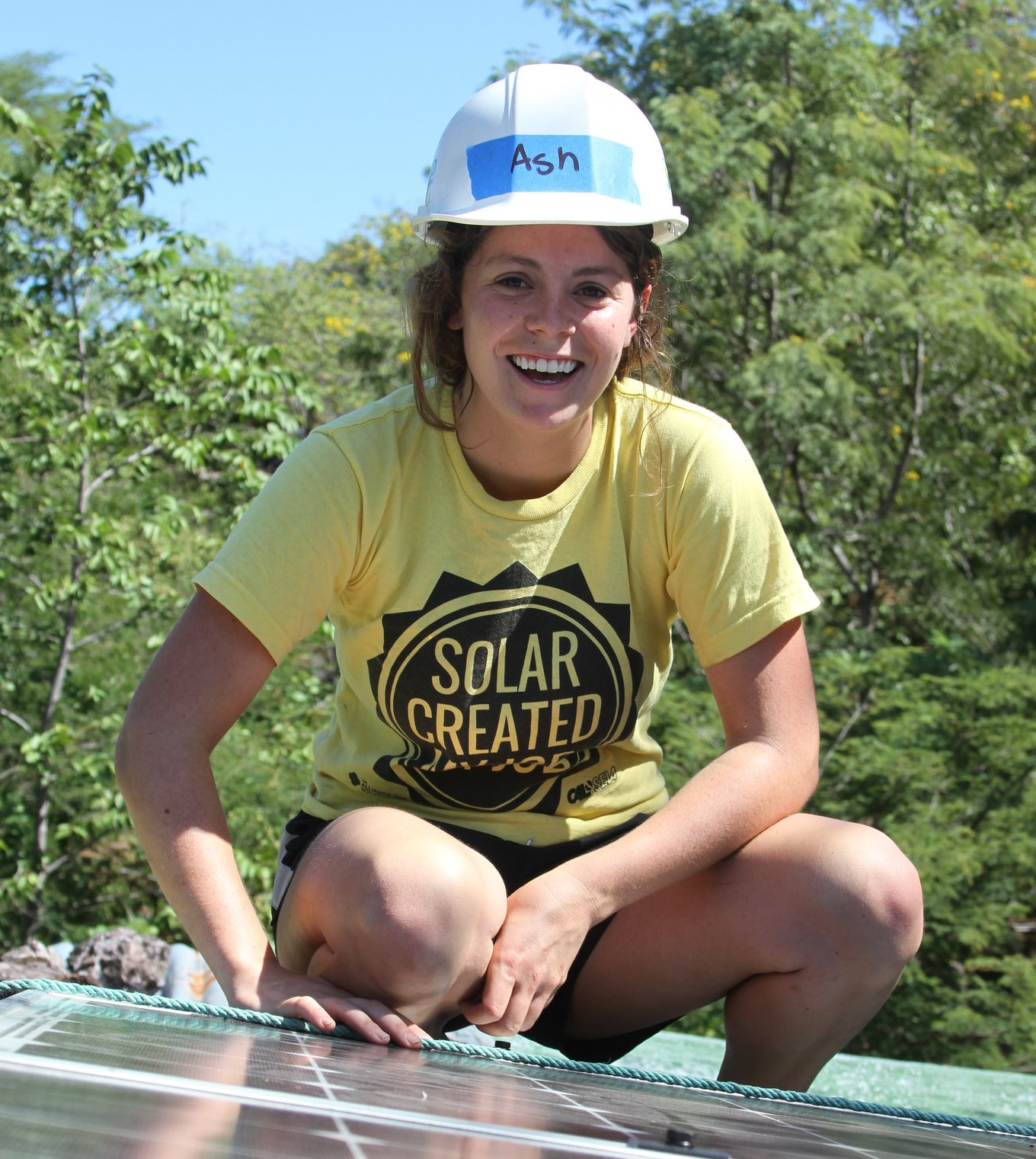 Ashley Gremel on a rooftop with solar in Esteli, Nicaragua.