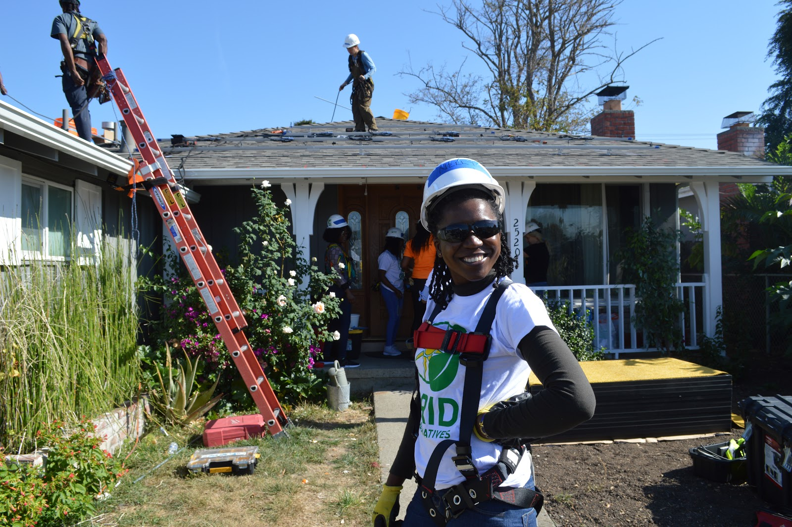 A GRID volunteer smiles at an install.