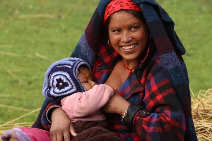 A Nepali mother nurses her new baby