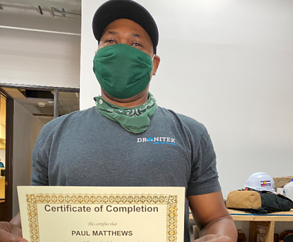 GRID trainee holds certificate