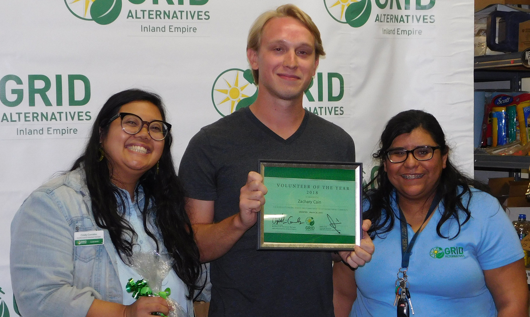 Volunteer of the Year Recipient Zachary Cain with Cindy Corrales and Sandra Romera