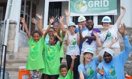 GRID staff with homeowner's family and volunteers