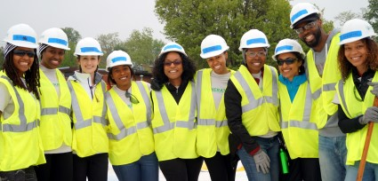 HAND volunteers pose before installing solar with GRID Alternatives