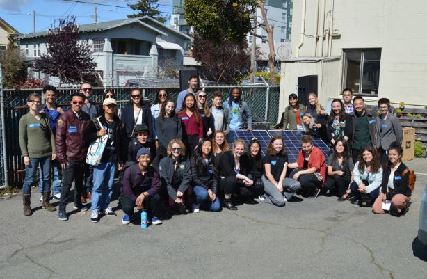 Environmental and social justice fellows from around the Bay Area pose with UC Berkeley students at Fellowship Summit in Oakland, California.