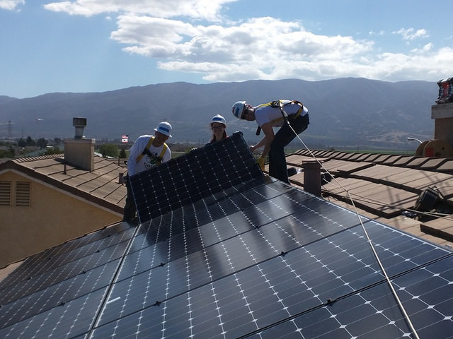 Job Trainees at work installing rooftop solar