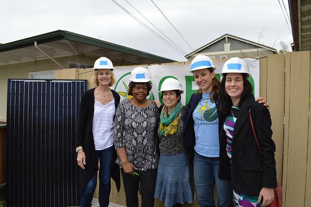 Lauren Swezey, of Facebook; Homeowner Gloria Williams, Diane Bailey, of Menlo Spark; Janelle London, of Menlo Spark; and Justine Blanchet, of Grid Alternatives