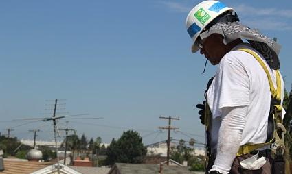 Gonzalo Varela surveys his work on a solar installation