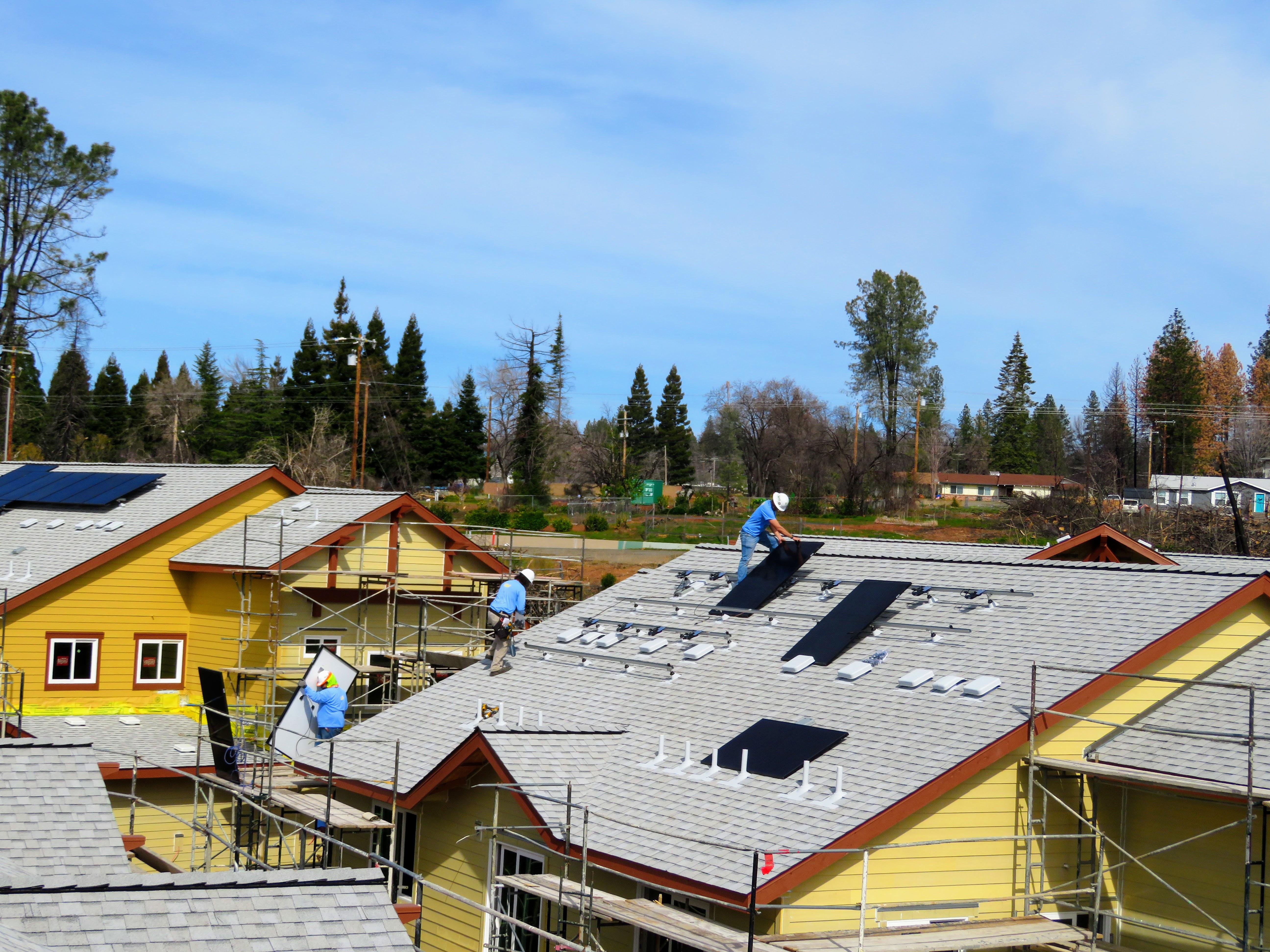 Solar panels being installed on Paradise Community Village