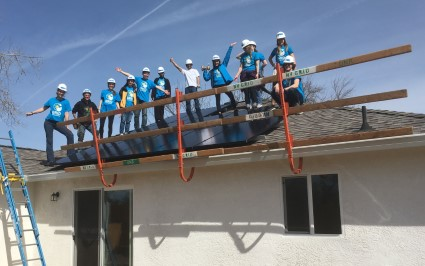 a group of people pose on a roof