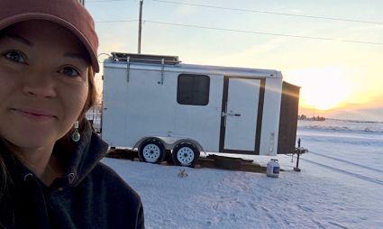 solar installer outside of her tiny home