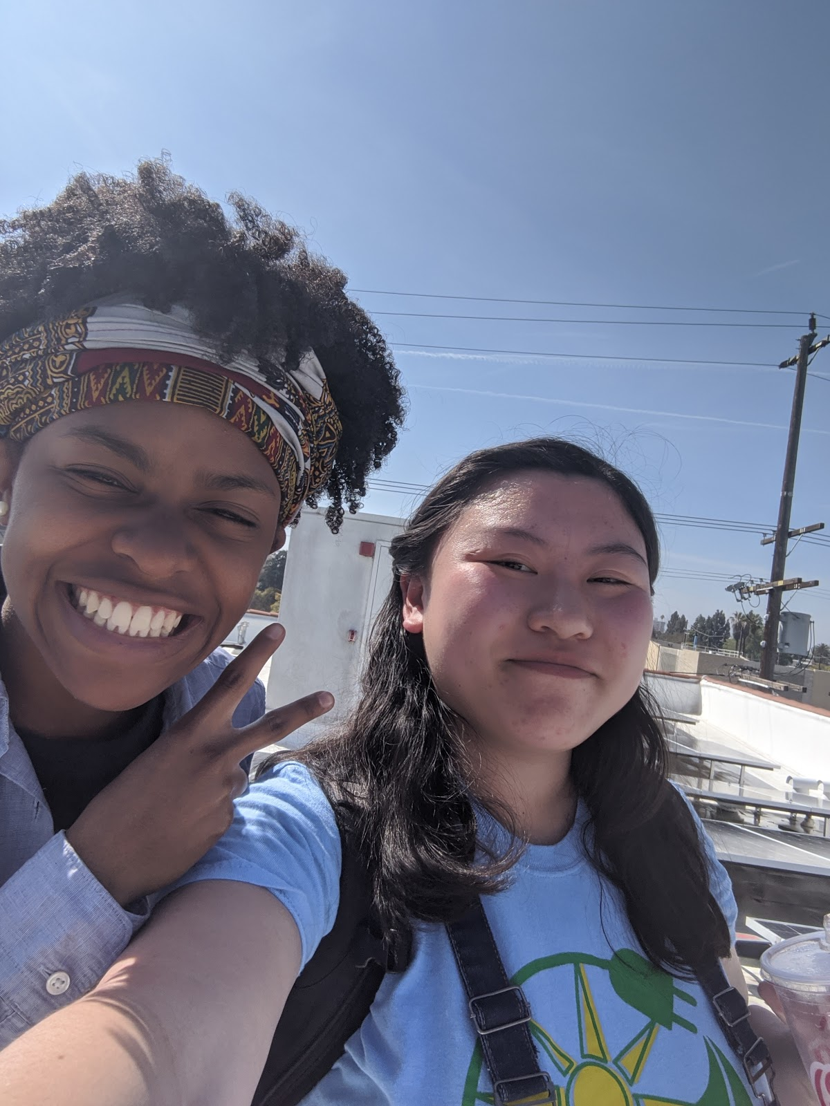 Image: Two women taking a selfie and making a peace sign gesture