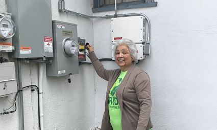 Women turns on her home solar system