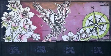 Photo of a mural with flowers, a bird, and a compass - photo taken by Wanda Lee-Stevens