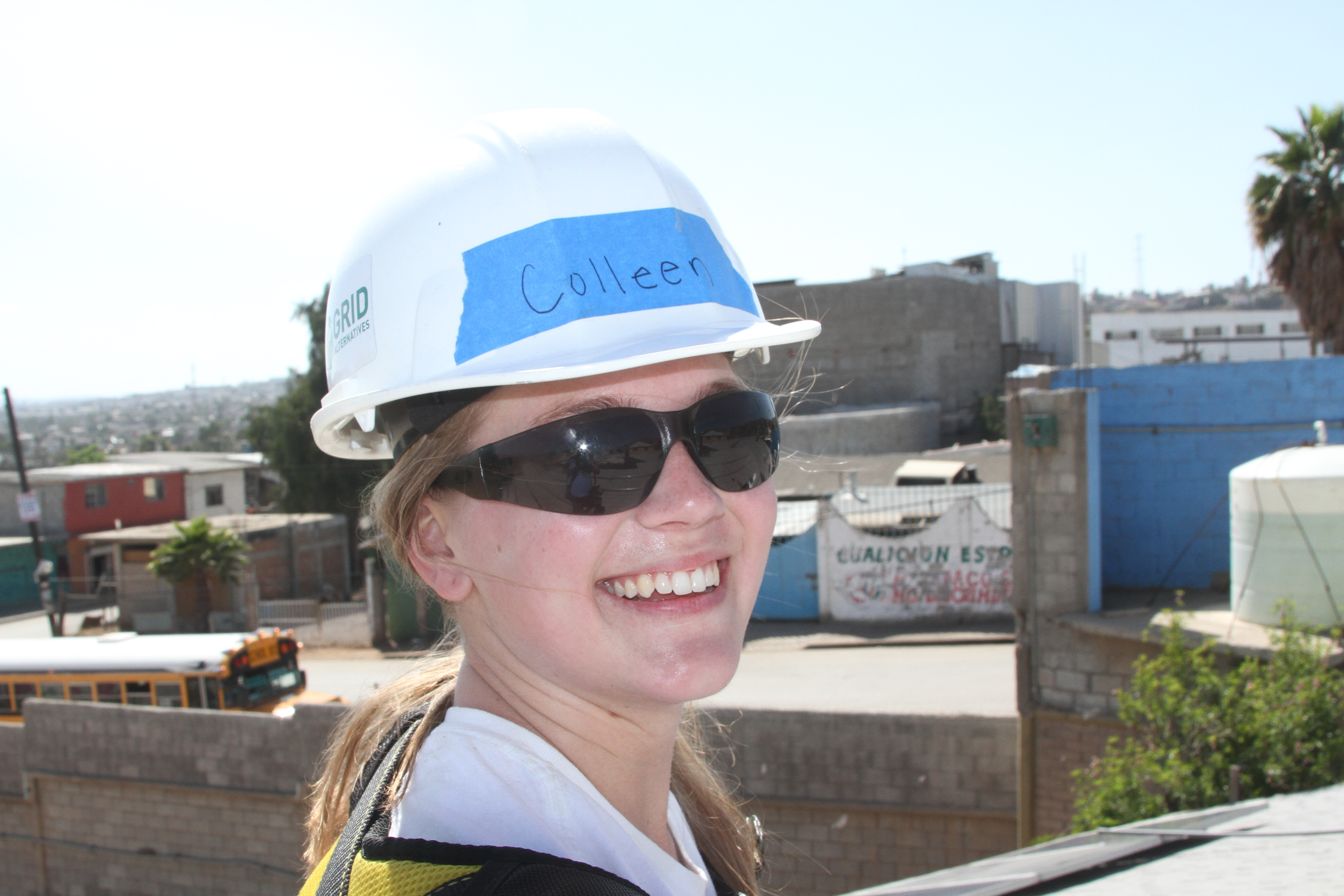 Colleen smiles with her hardhat during the installation
