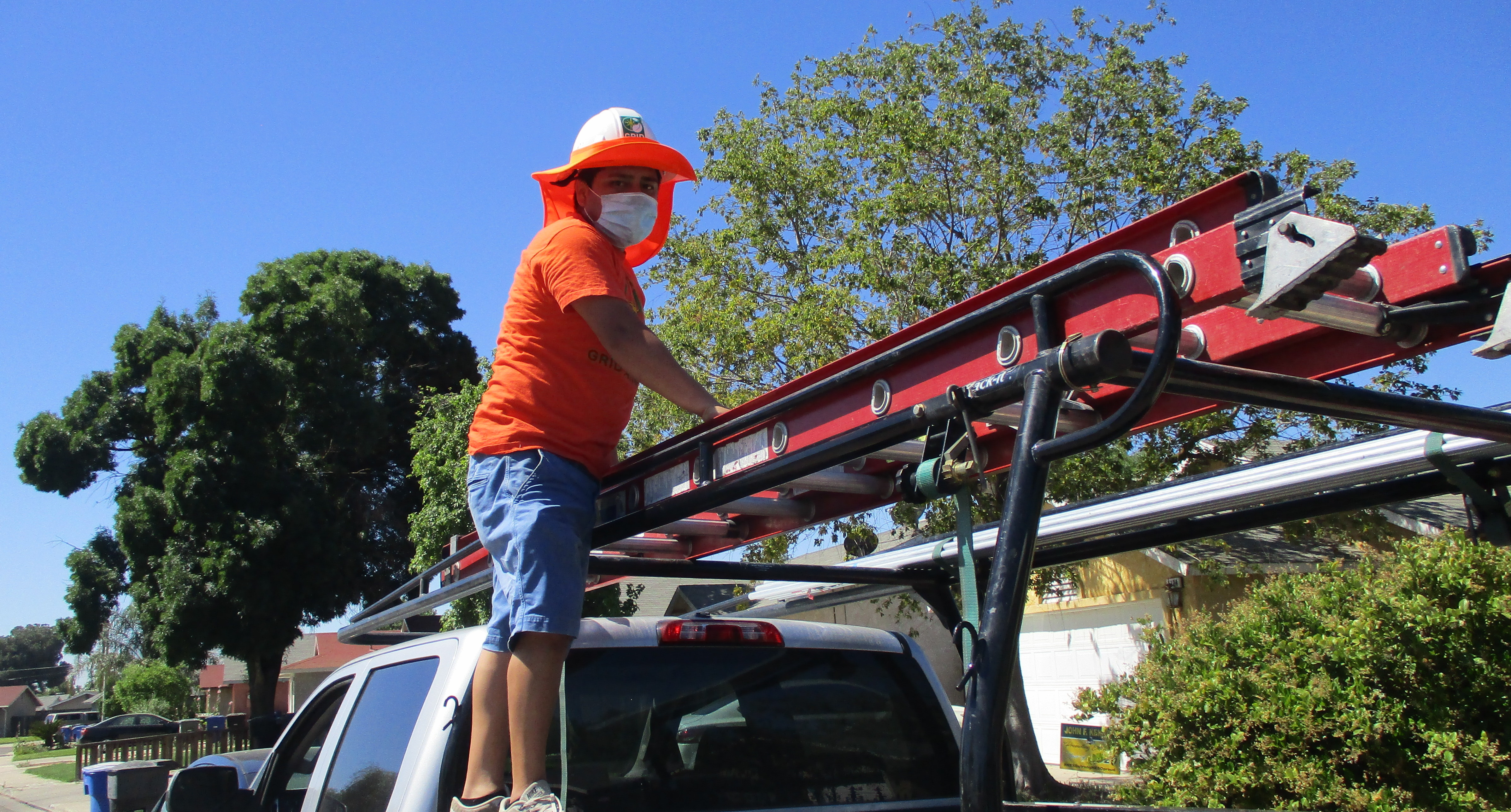 Installer on a truck with ladder