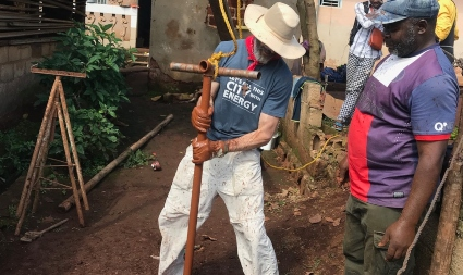 man works on outdoor water project