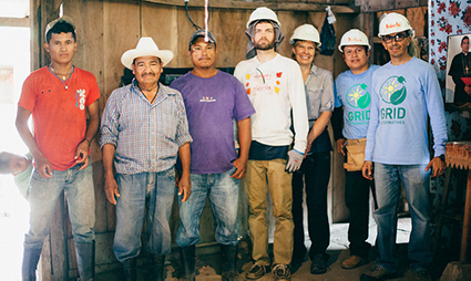 People in hard hats smile on construction site in Nicaragua