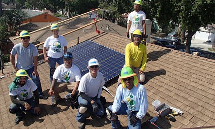 GRID Alternatives construction individuals stand on a roof