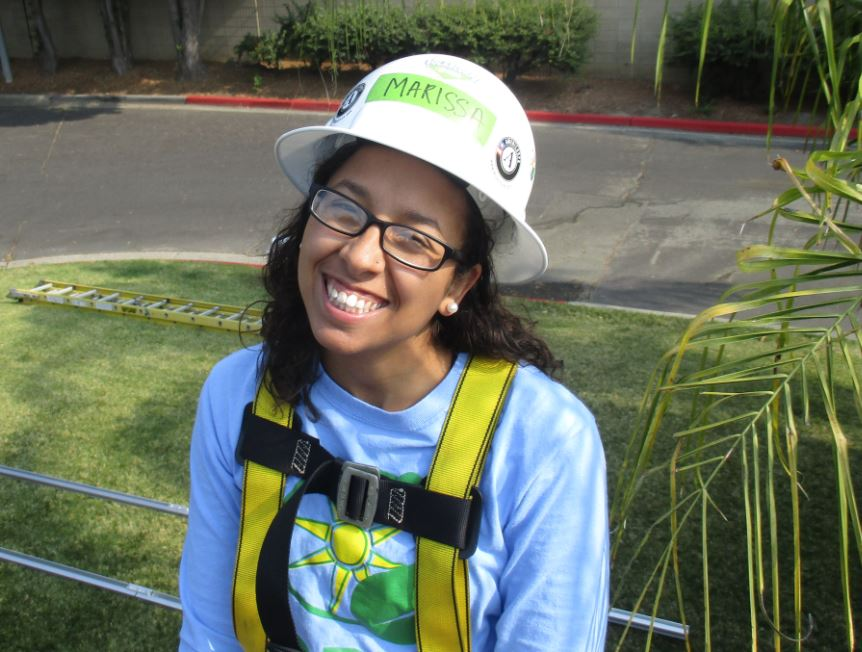 Marissa Leshnov smiles while on a GRID install in Pittsburg, California.