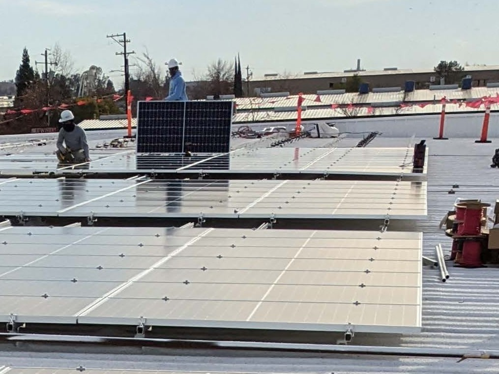 GRID staff in the process of installing solar on the North State Food Bank.