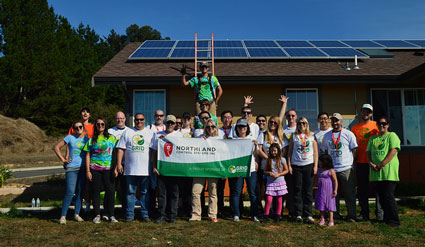 Northland Controls volunteers and GRID staff celebrate the completion of the installation with the clients.