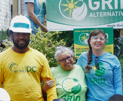 Ramonita Ramey standing with GRID staff and trainees after receiving no-cost solar.