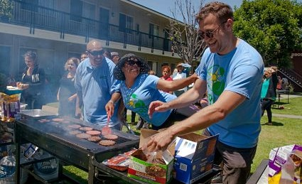 GRID Alternatives Greater Los Angeles staff opens up the bounty of our BBQ grill to residents