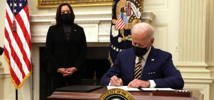 President Biden Signs Executive Orders, Vice President Kamala Harris Stands Nearby