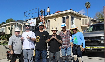 Constructions team members stand in front of a house