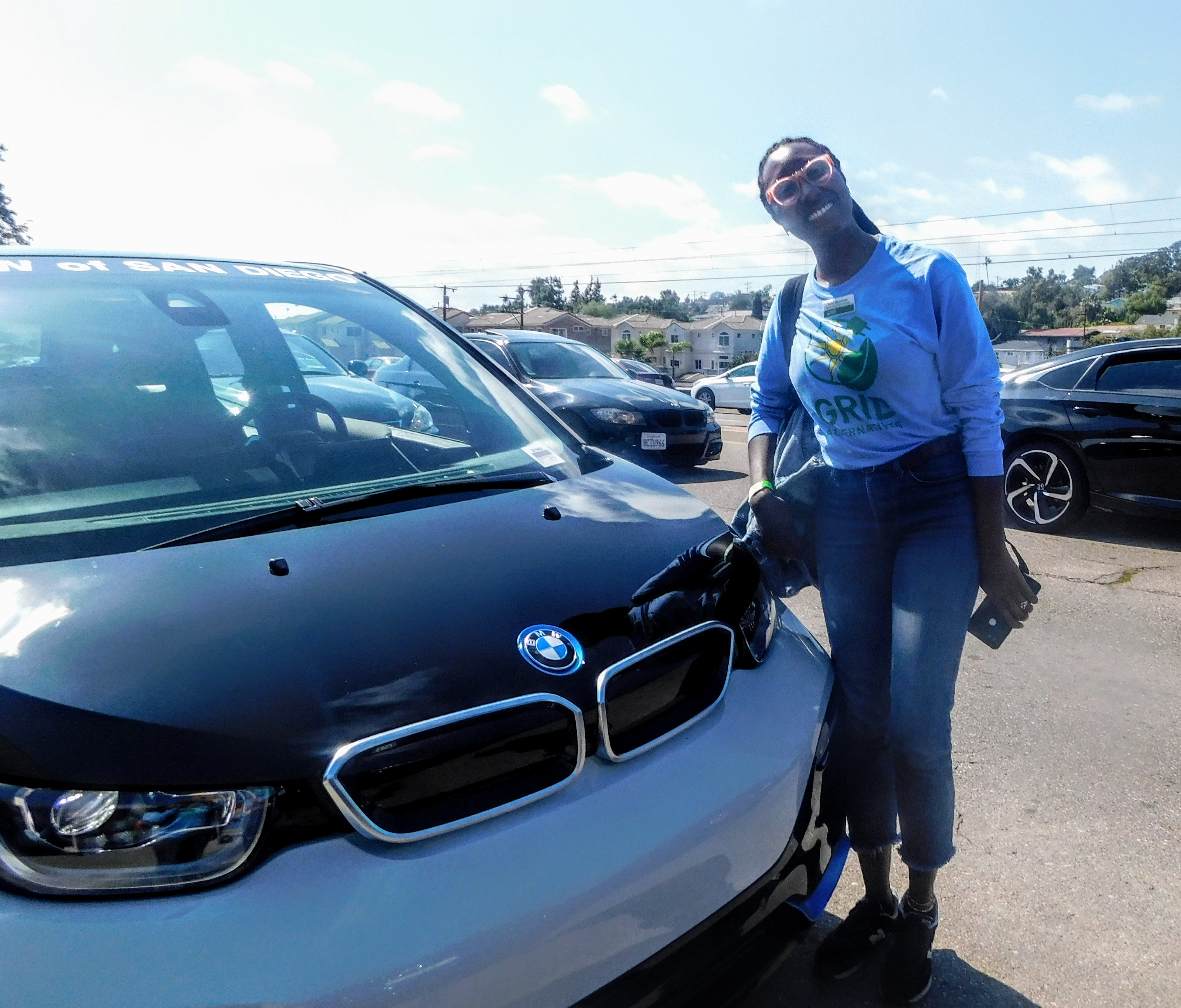 Terea stands by a BMW EV in San Diego