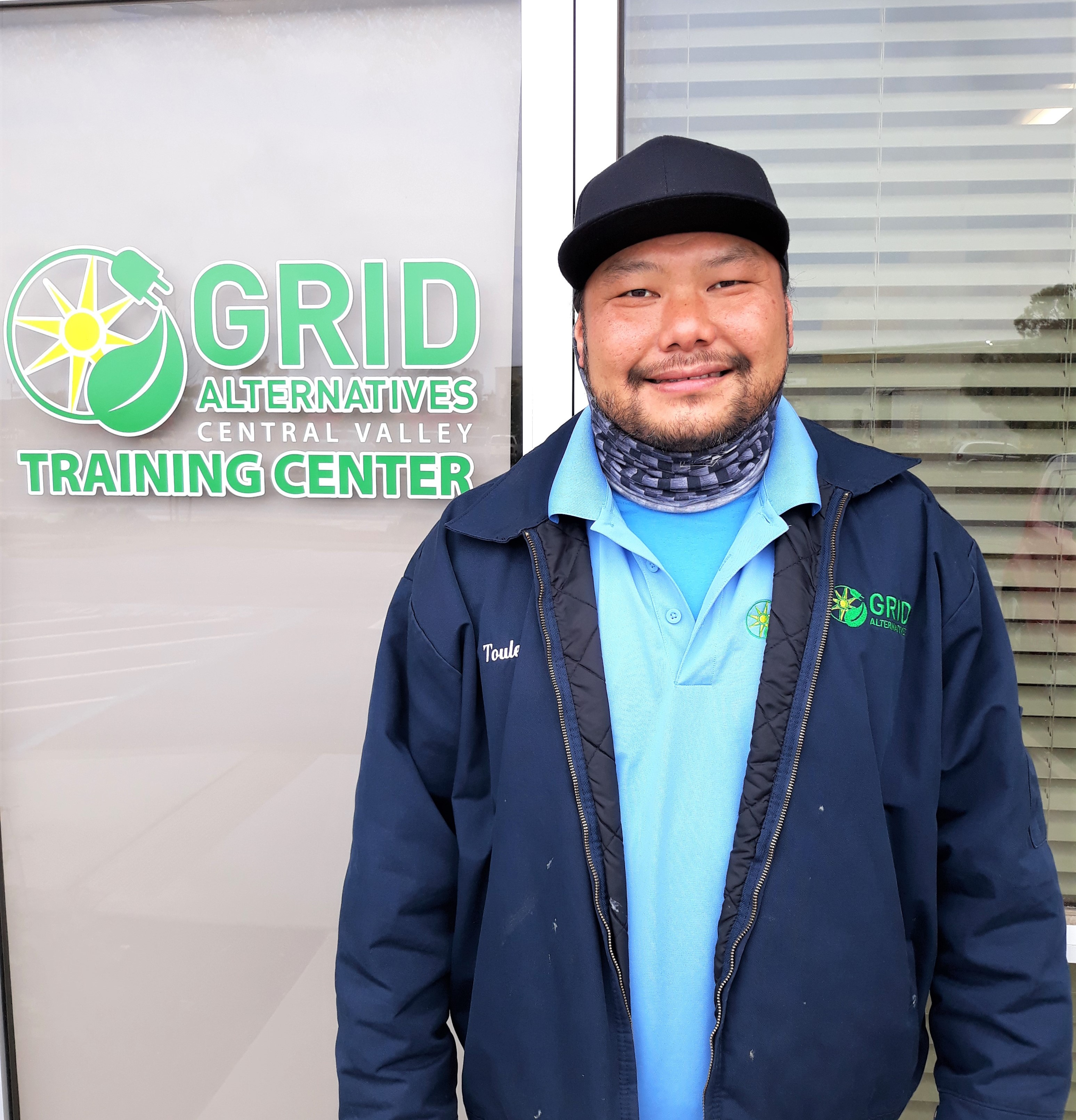Toulee Vang in front of the GRID Training Center