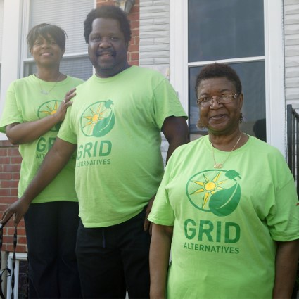 Wade poses with his two neighbors, Pamela and Mary, in GRID shirts