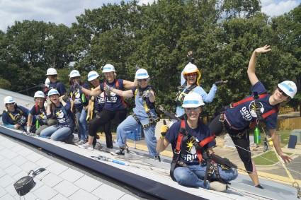 GRID volunteers pose on the rooftop!