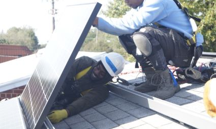 A Solar Works DC trainee connecting a solar module to an array.
