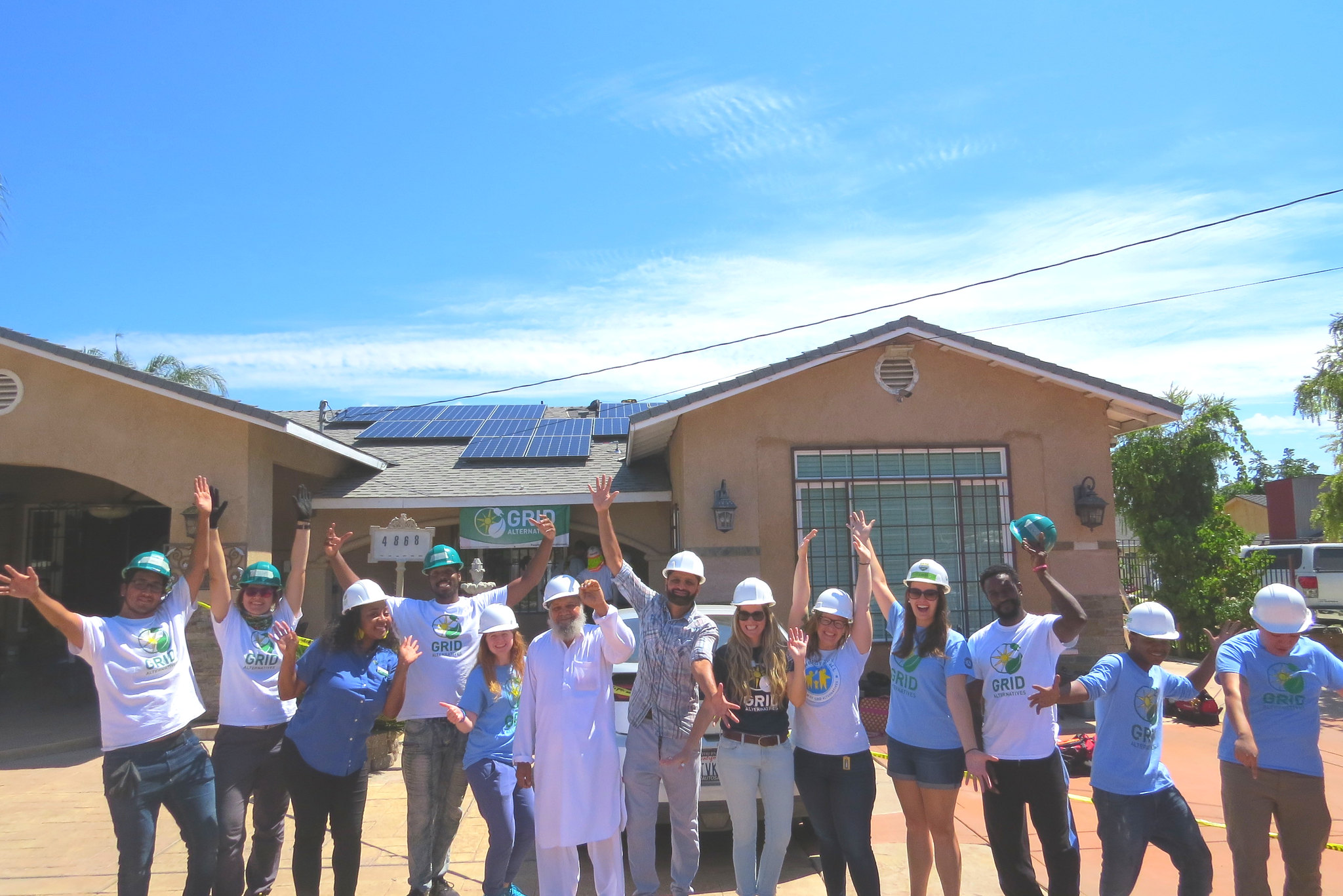 picture of everyone standing with homeowner at the install