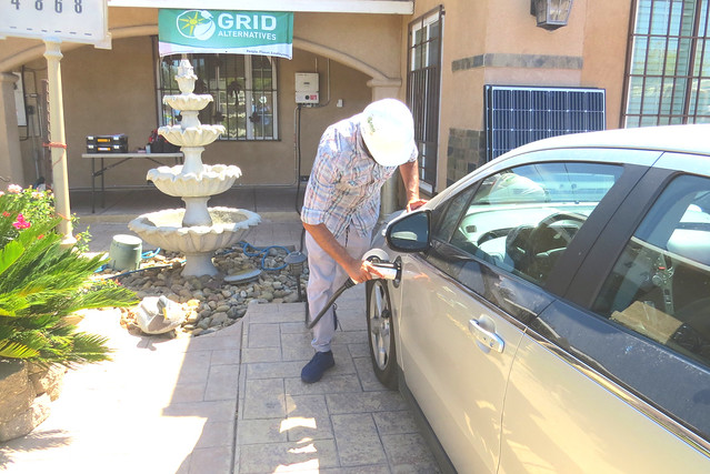 man plug up charger for electric vehicle