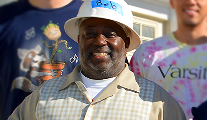 Homeowner Bob Wade smiles as a team of GRID volunteers install solar for his family.