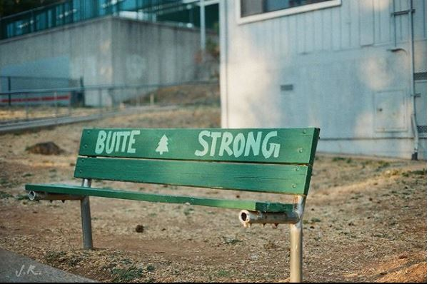 green bench that says Butte Strong
