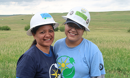 Cassandra and her mother Kim smile after completing the install.
