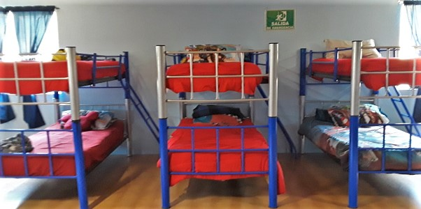 The children living in the orphanage sleep in a common room with bunk beds.